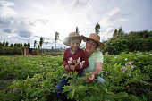 istock Female farmer teaching her son about harvesting the land 1319254570
