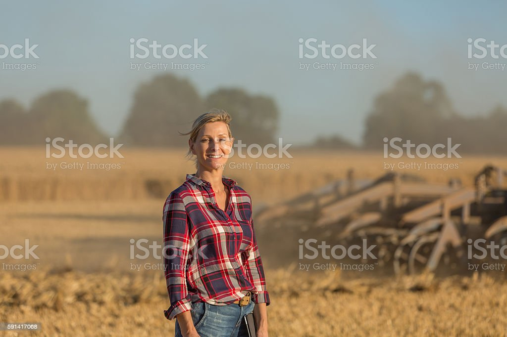 female farmer with tractor - Photo