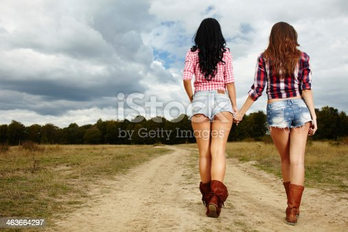 istock Female farmers walking in the countryside 463664297