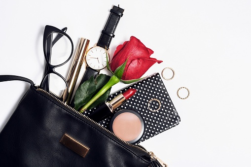 Female fashion accessories in black cosmetic bag.