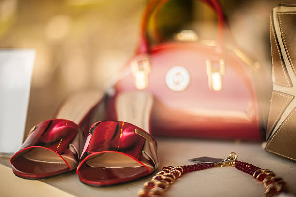Female fashion accessories in red and gold stock photo