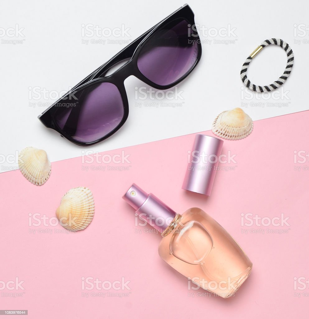 Female fashion accessories on a pink white pastel background....