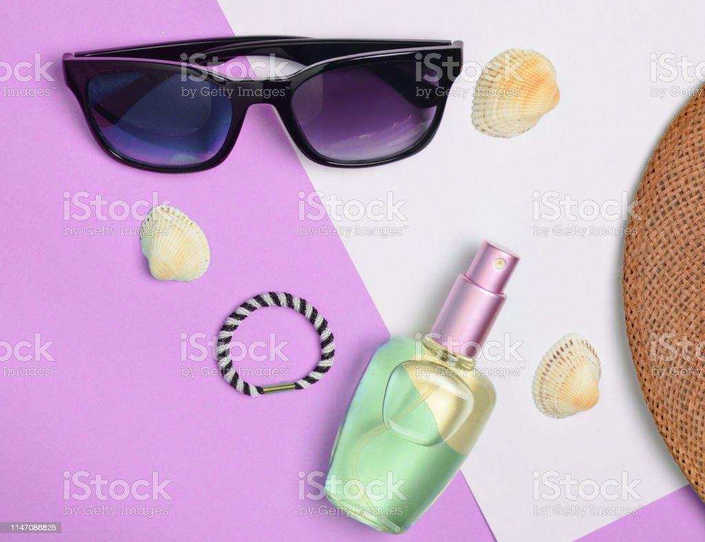 Female fashion accessories on purple white pastel background....
