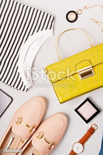 847905020 istock photo Female fashion accessories, shoes, shirt, notepad, makeup and handbag. Beauty blog, urban outfit and fashion trends  idea 1202578455