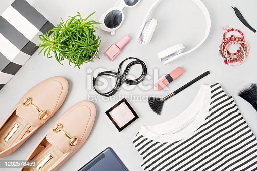 847905020 istock photo Female fashion accessories, sunglasses, notepad, makeup and handbag in black and white colors. Beauty, urban outfit and fashion concept 1202578459