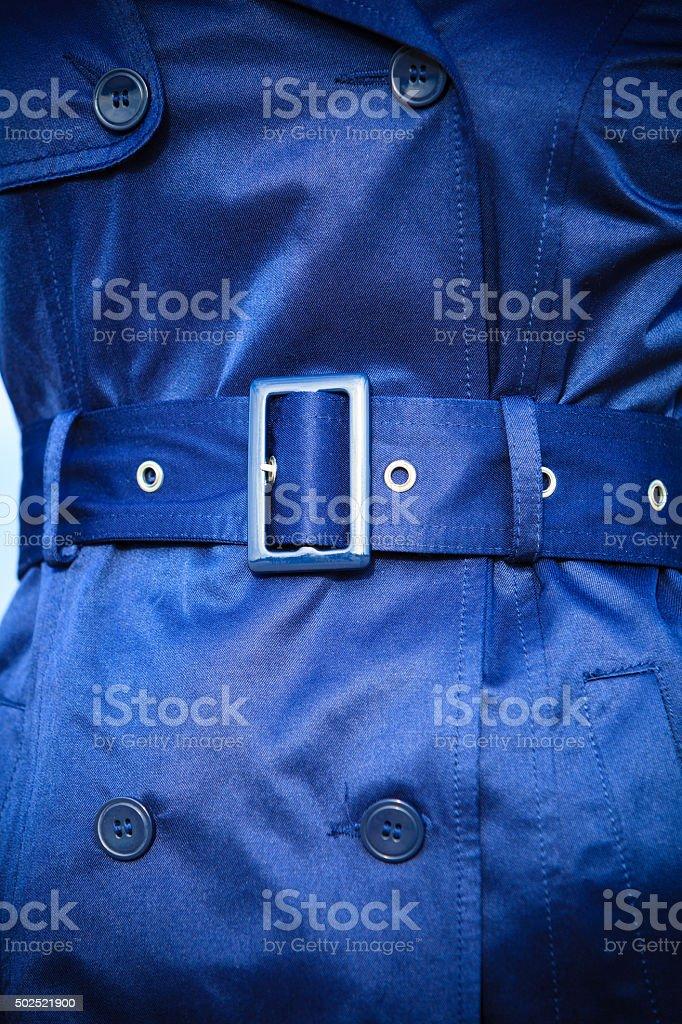 Female fashion. Closeup blue coat wit belt stock photo