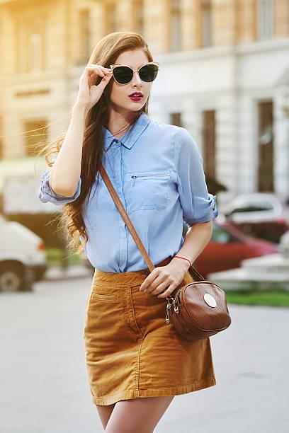 female fashion concept. outdoor portrait of young beautiful confident lady - damen rock braun stock-fotos und bilder