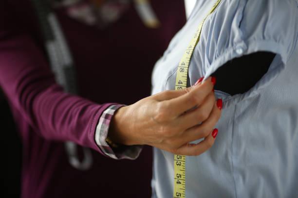 Female fashion designer arm making new stock photo