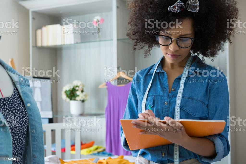 Female Fashion Designer Drawing In Book Stock Photo Download Image Now Istock