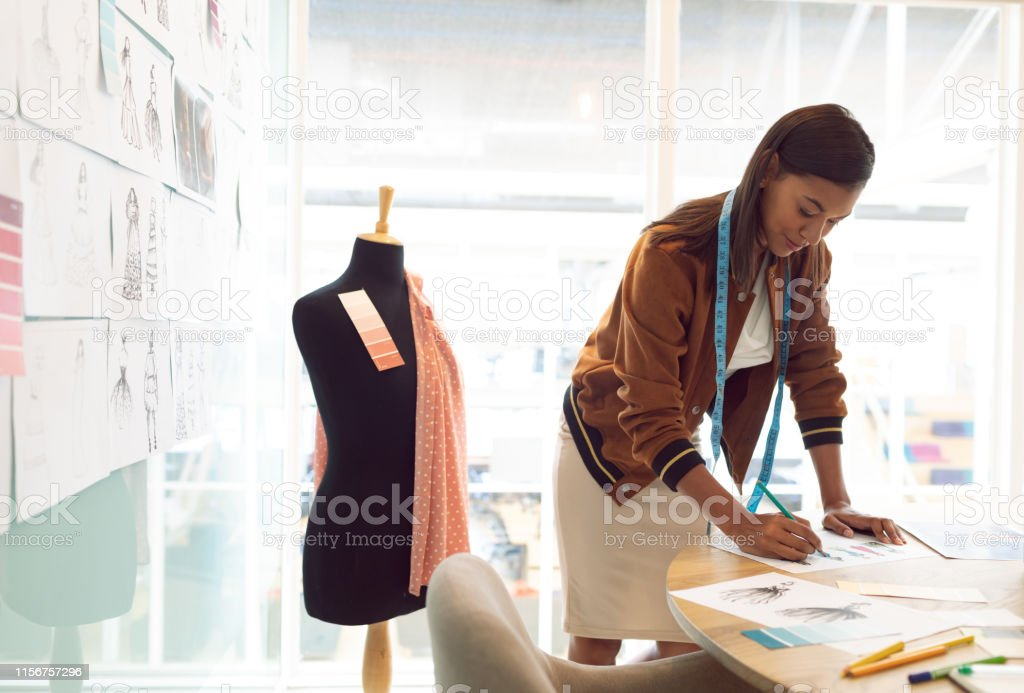 Female Fashion Designer Drawing Sketch On Table In A Modern Office Stock Photo Download Image Now Istock