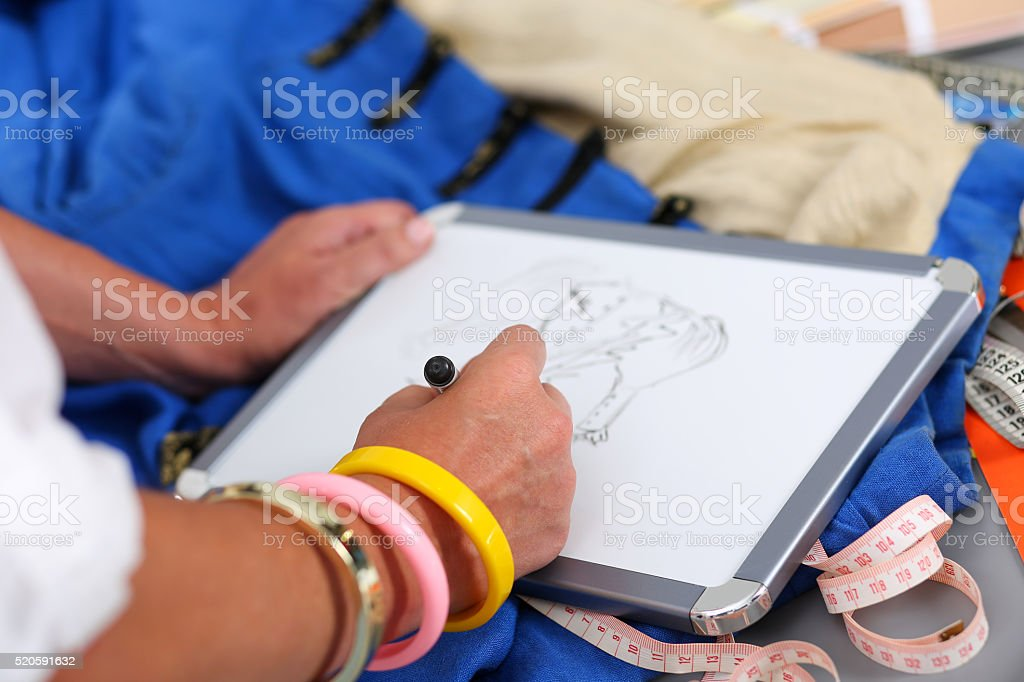 Female Fashion Designer Hands Holding Drawing Pad And Pen Making Stock Photo Download Image Now Istock
