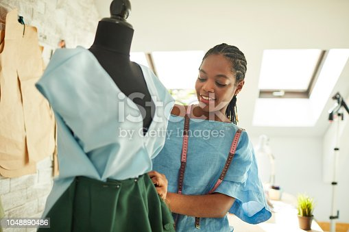 Young African female designer working in her workshop.