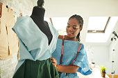 Female Fashion Designer In Her Workshop