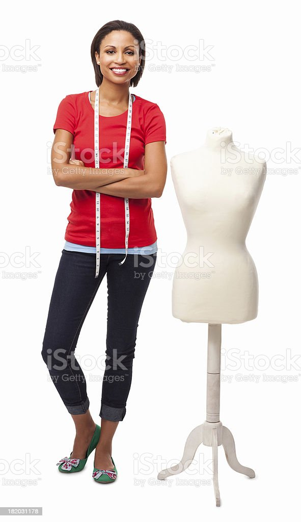 Female Fashion Designer Standing By Mannequin - Isolated stock photo