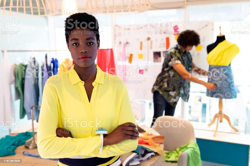 Female Fashion Designer Standing With Arms Crossed In Design Studio Stock Photo Download Image Now Istock