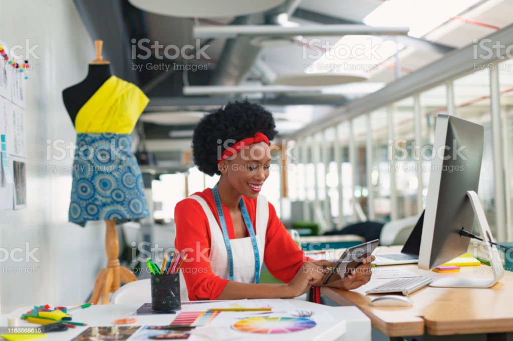 Female Fashion Designer Using Digital Tablet At Desk Stock Photo Download Image Now Istock