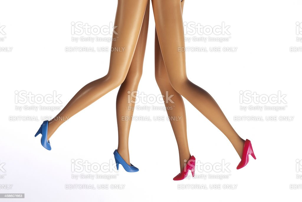 female fashion doll legs on high heels stock photo
