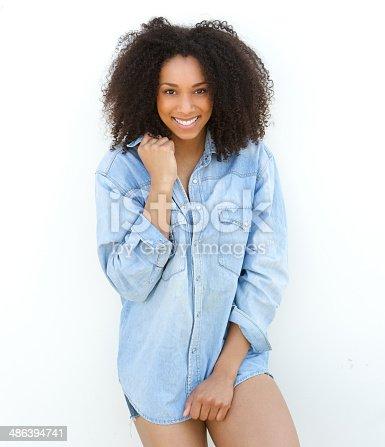 istock Female fashion model smiling outdoors. 486394741