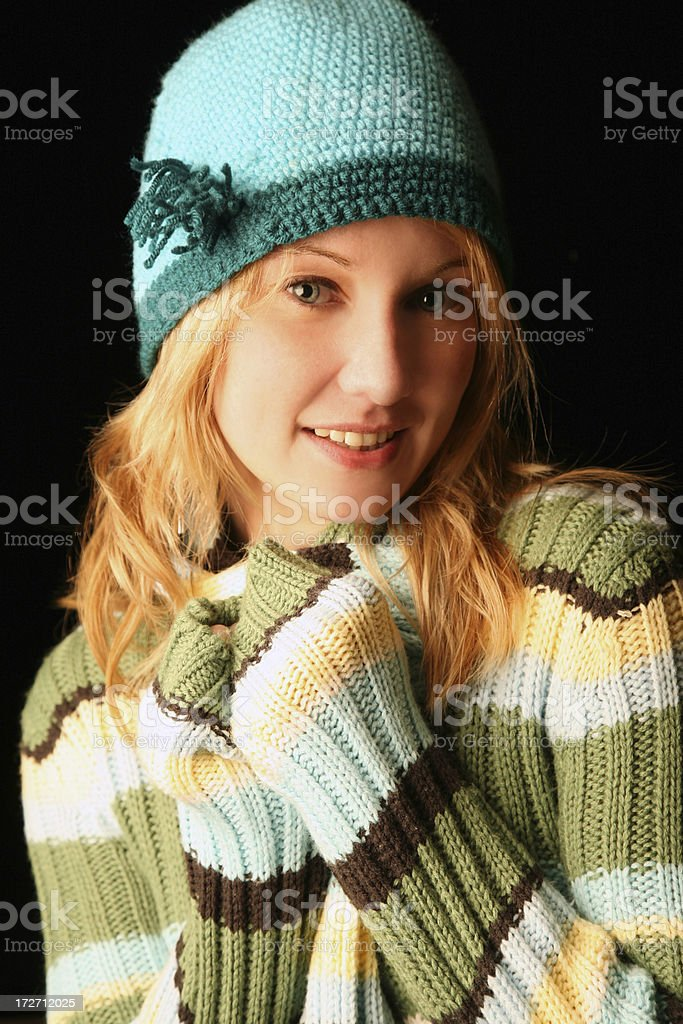 Female Fashion Model smiling wearing winter beannie and striped sweater stock photo