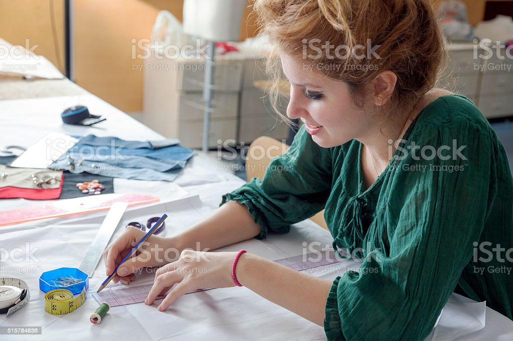 Female Fashion Student is Sketching A New Design stock photo