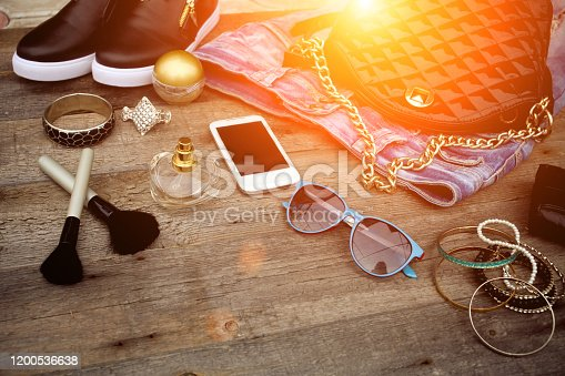 847905020 istock photo Female fashionable accessories on a wooden background. 1200536638