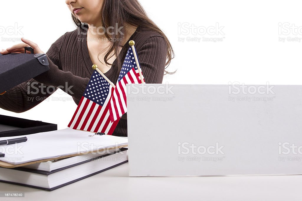 Female Federal or State Worker with a Bank Sign stock photo