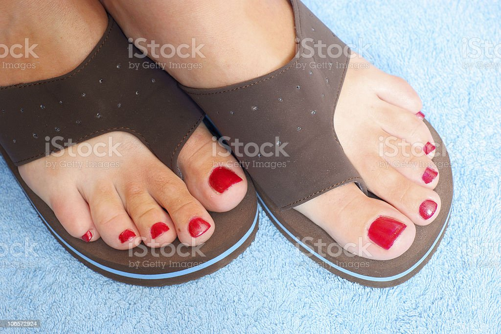 female feet and brown flip-flop royalty-free stock photo