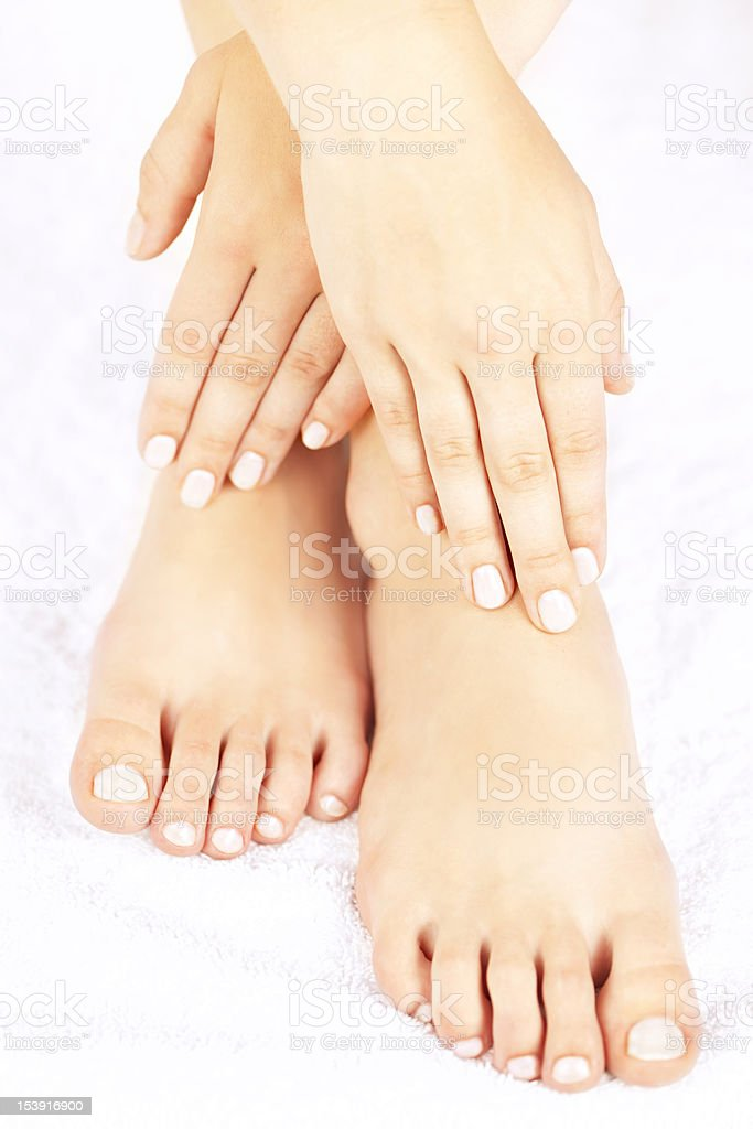 Female feet and hands royalty-free stock photo