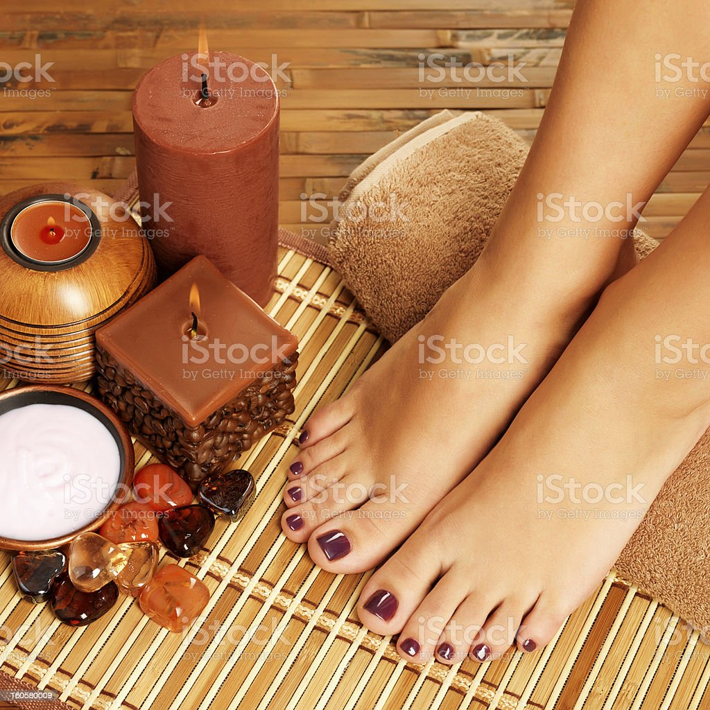 female feet at spa salon on pedicure procedure royalty-free stock photo