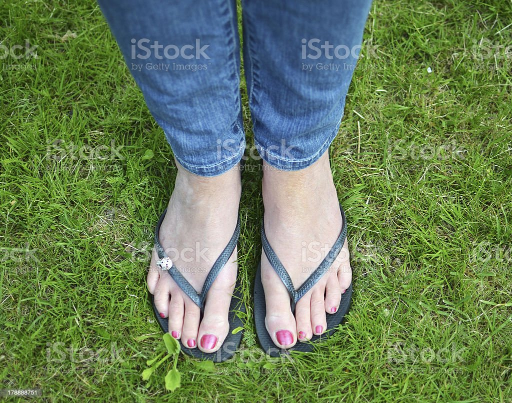 female feet in flip flops with nail polish stock photo & more