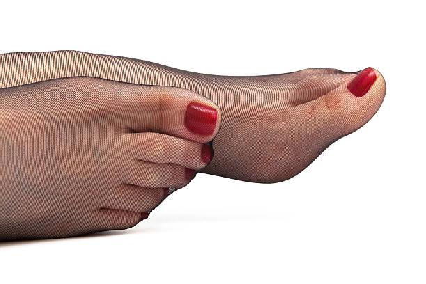 weibliche füße in strümpfe - nylon stock-fotos und bilder