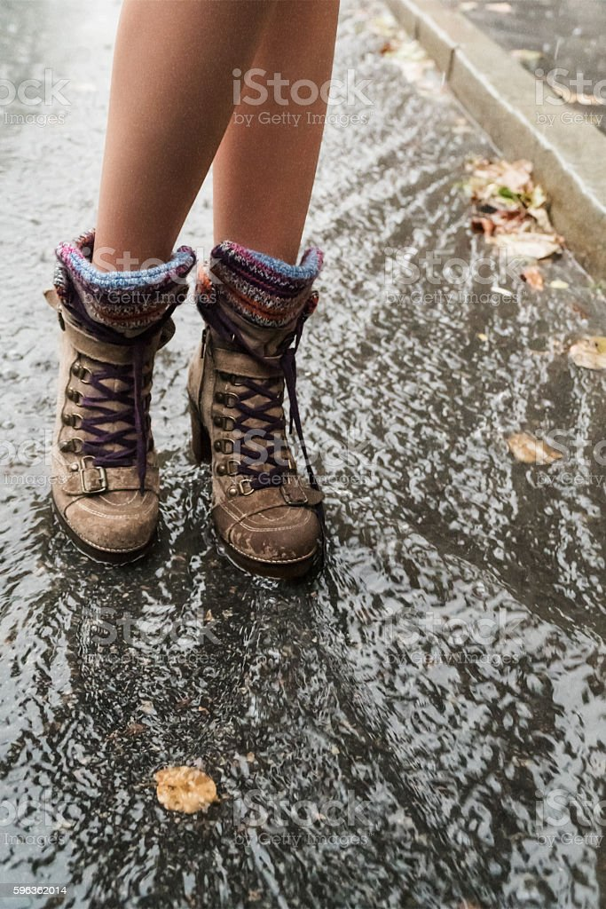 Female feet in the rain royalty-free stock photo