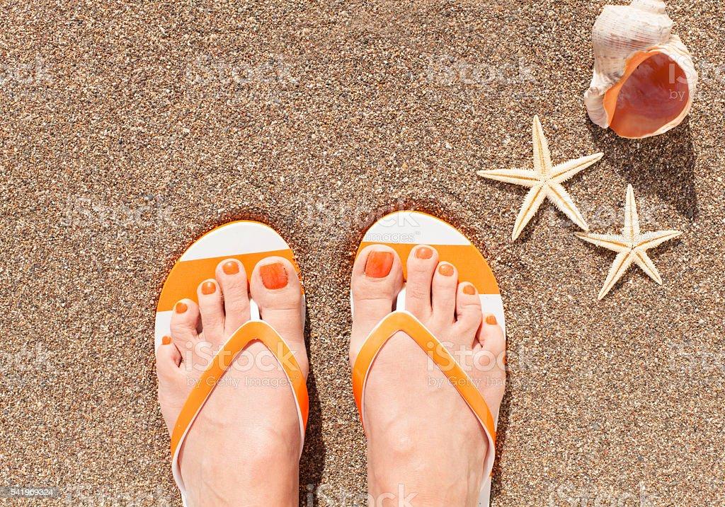 Female feet on sand stock photo