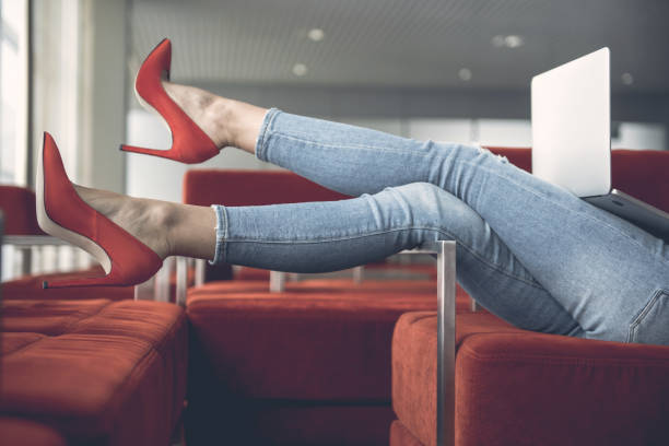 Female feet wearing red high heel shoes stock photo