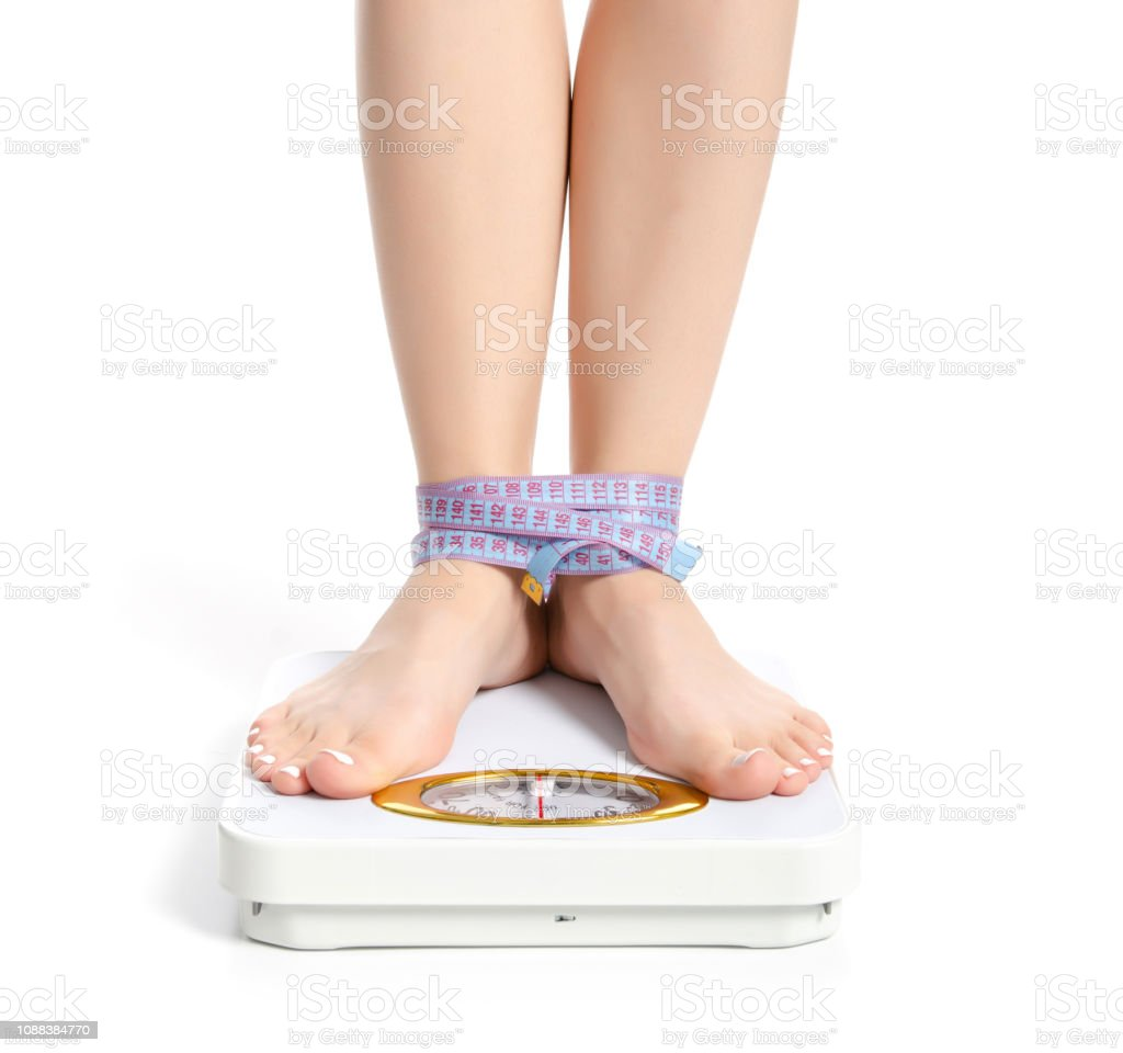 Female feet weighing scale centimeter stock photo