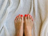 Female feet with bright pedicure