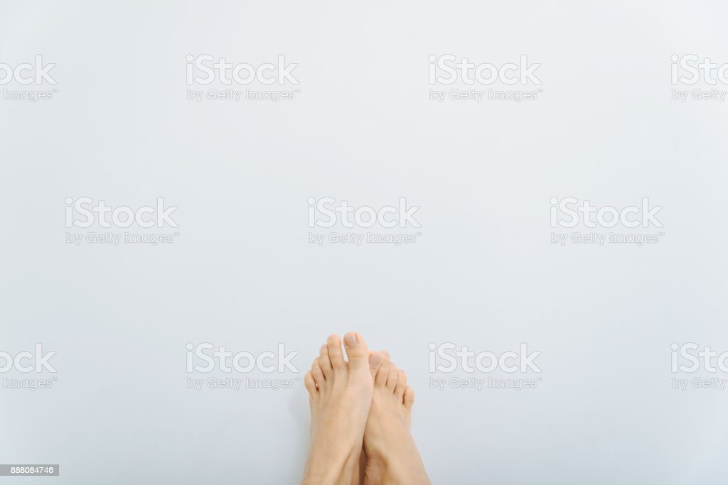 female feets on white background stock photo
