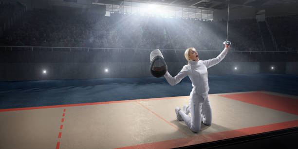 Female fencer emotionally rejoices victory on the big professional stage stock photo