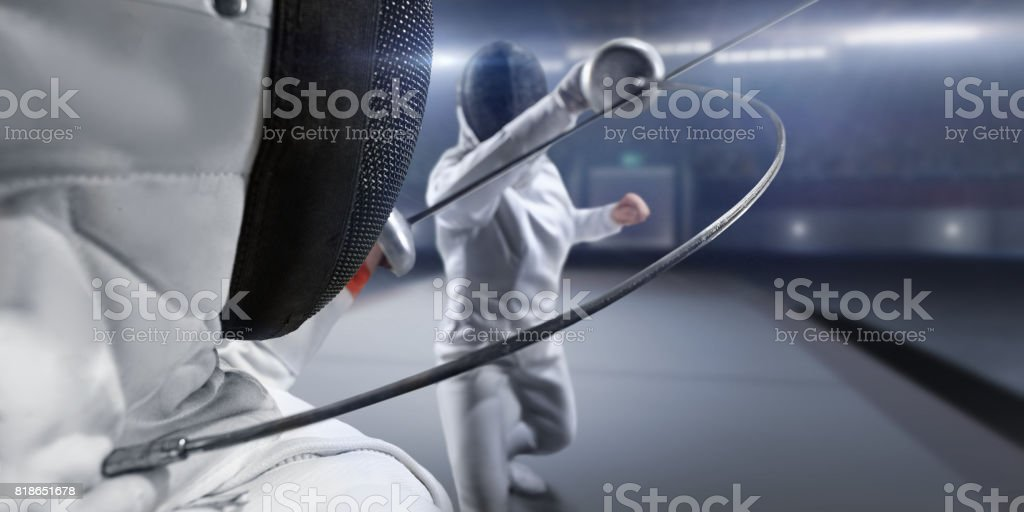 Female fencer fight on big professional stage stock photo