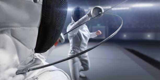 female fencer fight on big professional stage - indumento sportivo protettivo foto e immagini stock
