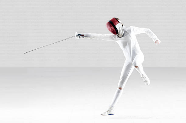 Female Fencer In Action stock photo
