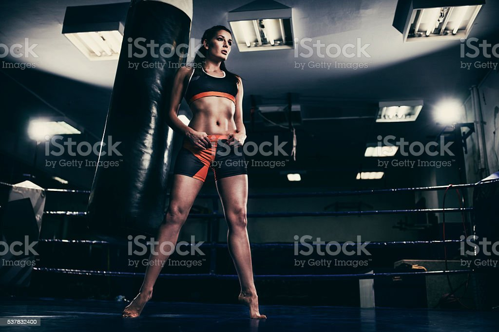 Female figher in a boxing ring stock photo
