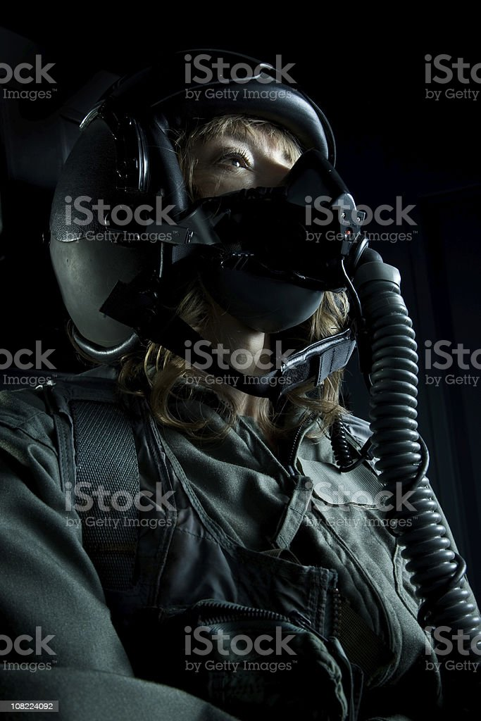 Female Fighter Plane Pilot Wearing Helmet and Oxygen Mask stock photo