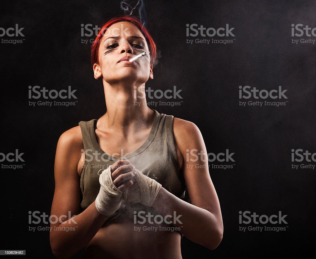Female fighter, preparing to fight stock photo