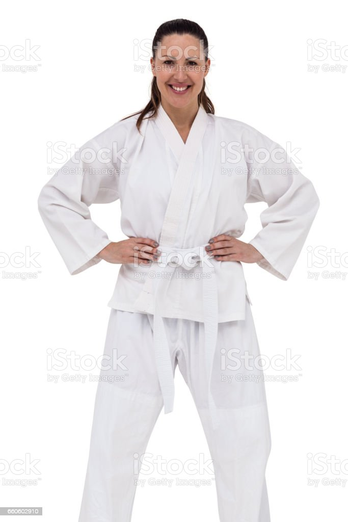 Female fighter standing with hand on hip royalty-free stock photo