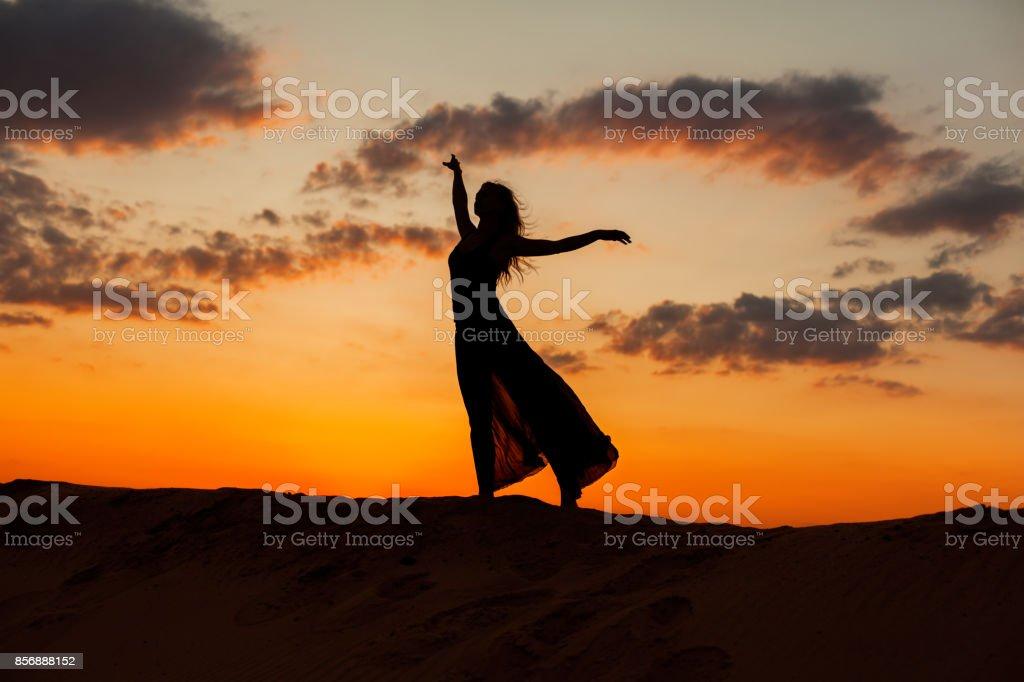 Female figure against the sky. stock photo