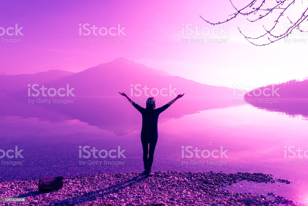 Female figure with wide open arms. Fantastic nature mountain peaks...