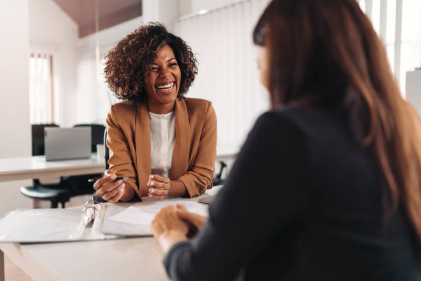 Female financial advisor consulting a client stock photo