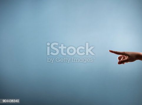 515789546istockphoto Female finger pointing - studio shot (Click for more) 904438340