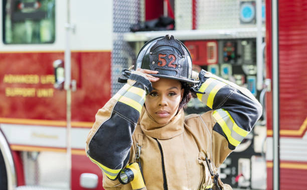 Female firefighter in fire protection suit stock photo